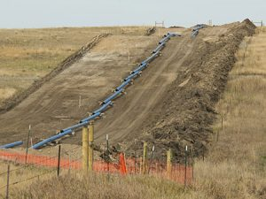 Natural gas pipline being run on farm field