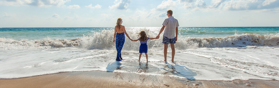 family on vacation at the beach