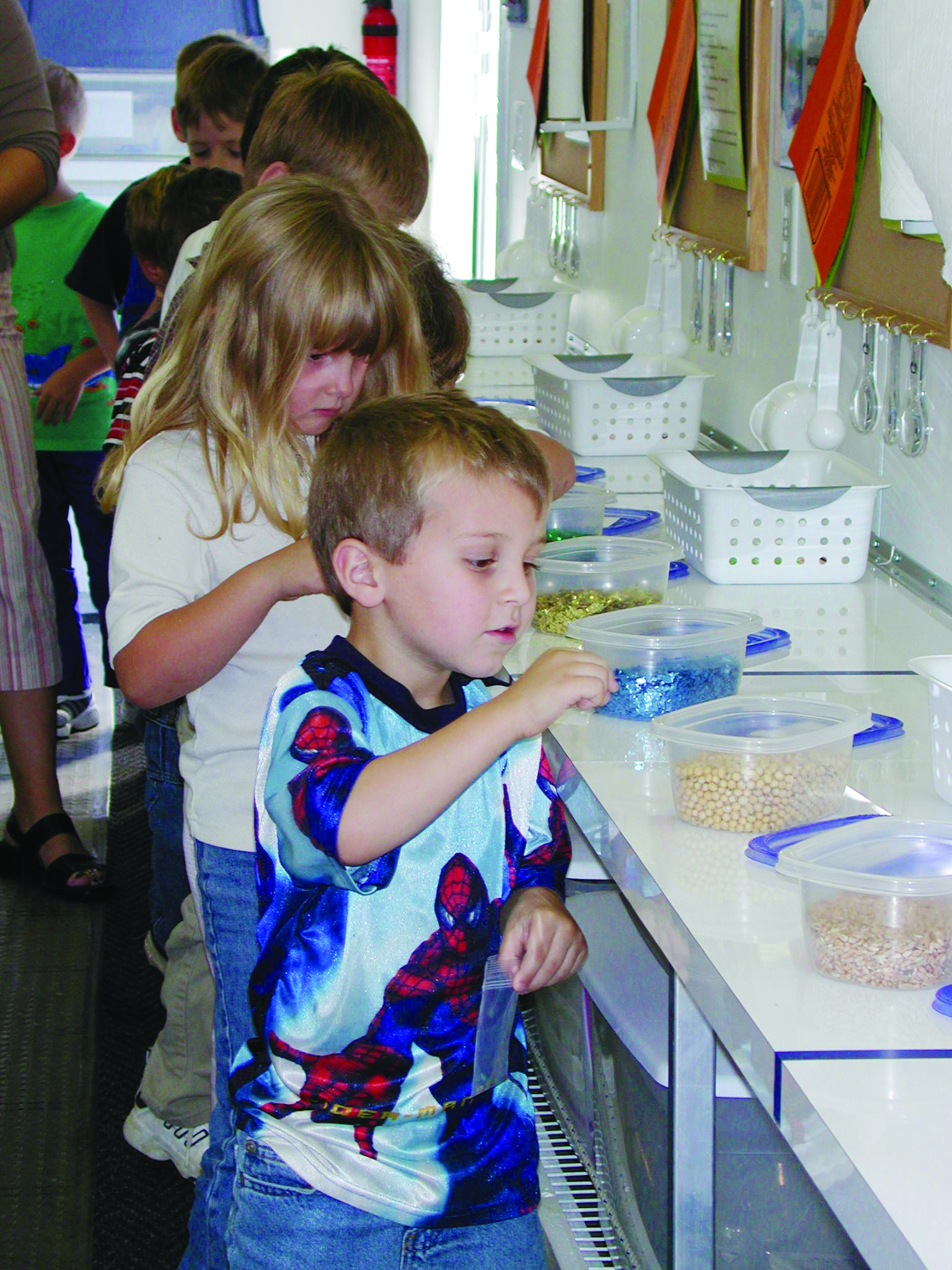 children doing an experiment in the mobile ag lab